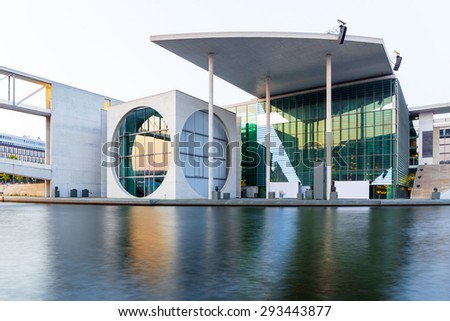 Berlin, Germany - July 03, 2015. Part of the german chancellery building on the river Spree in the government district in Berlin at sunset.