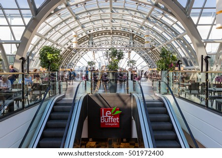 BERLIN, GERMANY - JULY 24: Unknown people are eating and drinking in the restaurant of the  famous department store KaDaWe in Berlin on Juli 24, 2013 in Berlin, Germany