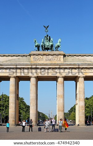 BERLIN, GERMANY - JUN 4: Tourist visiting at Brandenburg gate, it is a triumphal arch, a city gate in the center of Berlin on June 4, 2011 in Berlin, Germany. one of the most known landmarks of Berlin.