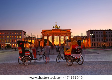 BERLIN, GERMANY - JUN 3: Tricycle used for commuting of tourist visiting at Brandenburg gate in beautiful night on June 3, 2011 in Berlin, Germany. It is one of the most known sites in Berlin