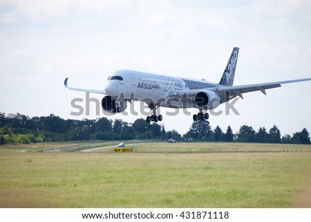 BERLIN / GERMANY - JUNE 3,2016: Airbus A 350 - 900 plane lands on airport in Berlin / Germany on June 3, 2016.
