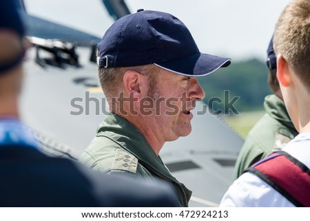 BERLIN, GERMANY - JUNE 03, 2016: An officer of the German army and visitors exhibition ILA Berlin Air Show 2016