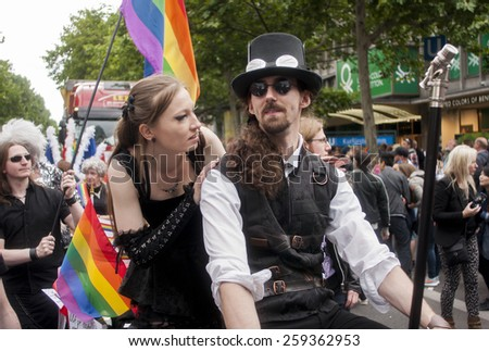 BERLIN, GERMANY - JUNE 21, 2014:Christopher Street Day.Crowd of people Participate in the parade celebrates gays, lesbians, and trans-genders. Prominent in the image, elaborately dressed participants.
