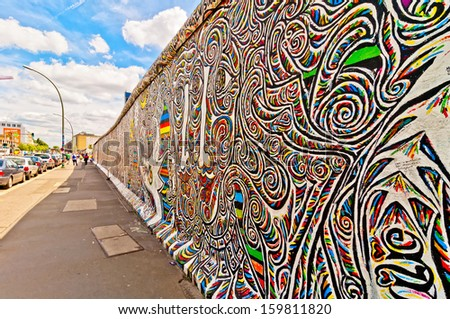 BERLIN, GERMANY - JUNE 10:  Graffiti at the East Side Gallery on June 10, 2013 in Berlin, Germany. The East Side Gallery is the longest preserved stretch of the Berlin wall. - stock photo