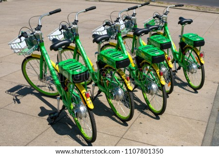 Berlin, Germany - june 2018: Many electric bicycles  of public bike sharing company LimeBike in  Berlin, Germany