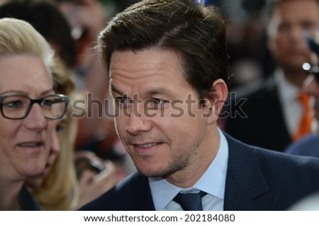 BERLIN - GERMANY - JUNE 29: Mark Wahlberg with Fans at the European premiere from Transformer 4 - Age of Extinction at CineStar,Sony Center on June 29, 2014 in Berlin, Germany. - stock photo