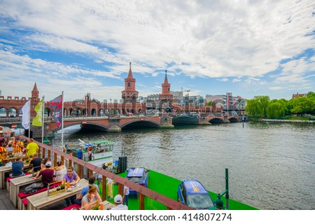 BERLIN, GERMANY - JUNE 06, 2015: Spree river cross under oberbaumbrucke, square on a side with excelent view