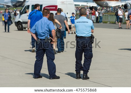 BERLIN, GERMANY - JUNE 03, 2016: The representative of the police and gendarmerie on the airfield. Ensuring public order. Exhibition ILA Berlin Air Show 2016
