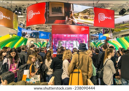 BERLIN, GERMANY - MARCH 8, 2014: attendees walking around Peru stand at ITB Travel Trade Show in the fairgrounds of Messe Berlin.  - stock photo