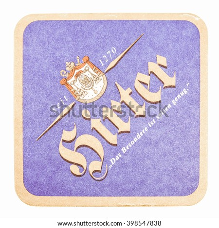 BERLIN, GERMANY - MARCH 15, 2015: Beermat of German beer Hirter isolated over white background vintage