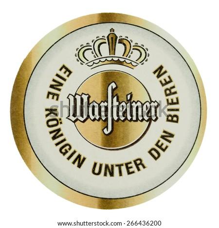 BERLIN, GERMANY - MARCH 15, 2015: Beermat of German beer Warsteiner isolated over white background - stock photo