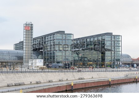 BERLIN, GERMANY - MARCH 03: Berlin Main Station (German Hauptbahnhof) on river Spree on Mar 03 2015 in Berlin, Germany. The station is operated by DB Station&Service, a subsidiary of Deutsche Bahn AG  - stock photo
