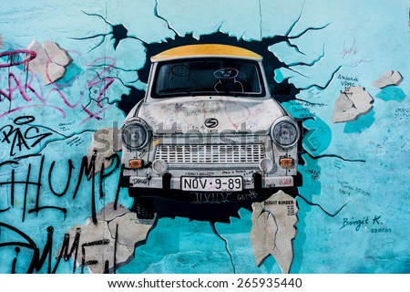 BERLIN, GERMANY - MARCH 20: Berlin Wall graffiti seen on March 22, 2015, Berlin, East Side Gallery. It's a 1.3 km long part of original Berlin Wall which collapsed in 1989. - stock photo