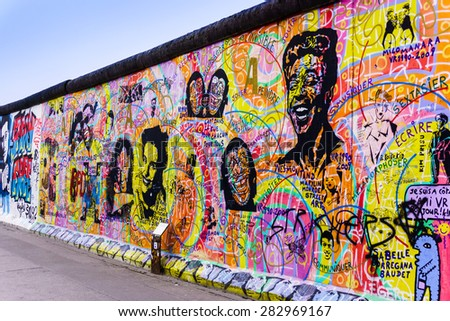 BERLIN, GERMANY - MARCH 20: Graffiti at the East Side Gallery on March 20, 2015 in Berlin, Germany. The East Side Gallery is the longest preserved stretch of the Berlin wall.