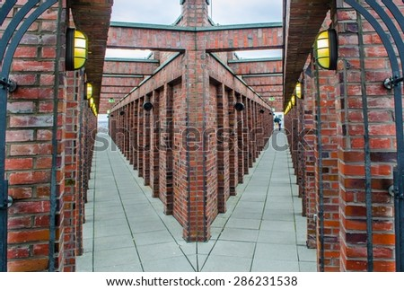 BERLIN, GERMANY, MARCH 12, 2015: symmetrical panorama platform at the top of skyscraper on potzdamer platz in berlin is made of bricks and offers great view over the city. - stock photo