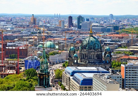 BERLIN, GERMANY - MAY 3, 2014: Aerial view of Berlin. Panorama of Berlin (Marienkirche, Berliner Dom) seen from the roof of the hotel Park Inn by Radisson in Alexanderplatz. - stock photo