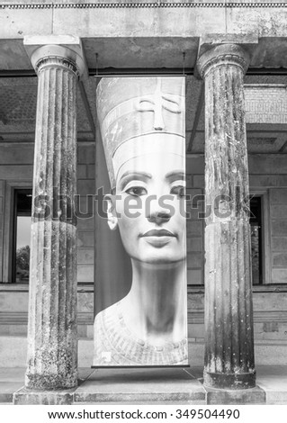 BERLIN, GERMANY - MAY 10, 2014: Banner of Queen Nefertiti of Egypt (known as Nofretete in German) in front of the Neues Museum which hosts her statue in black and white
