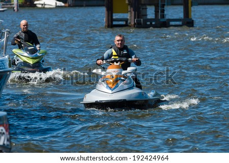 BERLIN, GERMANY - MAY 03, 2014: Demonstration rides on a water scooter. 2nd Berlin water sports festival in Gruenau