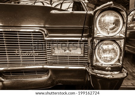 BERLIN, GERMANY - MAY 17, 2014: Detail of a full-size luxury car Cadillac Coupe de Ville (1967). Sepia. 27th Oldtimer Day Berlin - Brandenburg  - stock photo