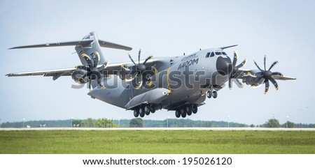 BERLIN, GERMANY - MAY 20, 2014: Four-engine turboprop military transport aircraft Airbus A400M (France) demonstration during the International Aerospace Exhibition ILA Berlin Air Show-2014. - stock photo