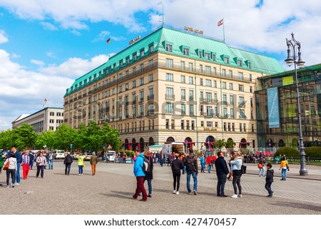 Berlin, Germany - May 14, 2016: Hotel Adlon Kempinski with unidentified people. Its a luxury hotel on Unter den Linden, at the corner with Pariser Platz, directly opposite the Brandenburg Gate