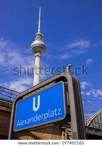 BERLIN, GERMANY - MAY 30, 2014: Metro station Alexanderplatz sign and Television tower.
