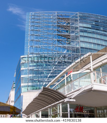Berlin, Germany - May 13, 2016: modern glass building on Kurfurstendamm in Berlin Charlottenburg. Berlin, Germany's capital, represents eclectic mixture of many architectural styles.