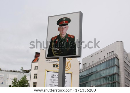 BERLIN, GERMANY-MAY 19: Picture of soviet soldier at the former East-West Berlin border, the check point Charlie remembering the cold war on May 19, 2010 in Berlin Germany - stock photo