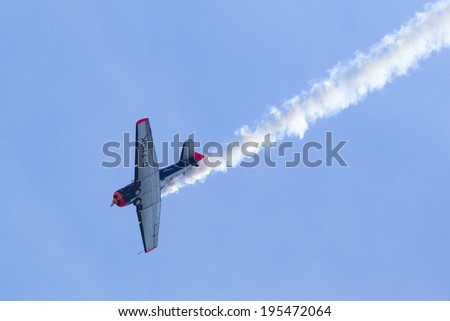 BERLIN, GERMANY - MAY 20, 2014: The aircraft Red Bull Noorduyn AT-16 D-FHGK demonstration during the International Aerospace Exhibition ILA Berlin Air Show-2014.