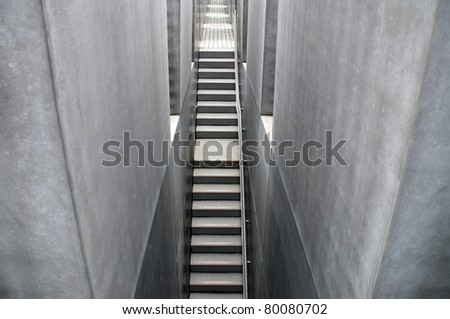 BERLIN, GERMANY - MAY 21: The Memorial to the Murdered Jews of Europe shown in Berlin on May 21, 2010. The memorial was designed by architect Peter Eisenman and engineer Buro Happold. - stock photo