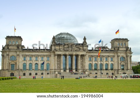 BERLIN, GERMANY - May 25, 2014: The Reichstag building and vacationers residents and visitors on the field.