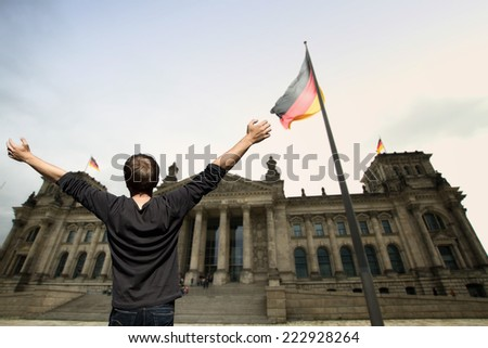 BERLIN, GERMANY - May 25, 2014: The Reichstag building and vacationers residents and visitors on the field. The Reichstag building is a historical edifice in Berlin. - stock photo