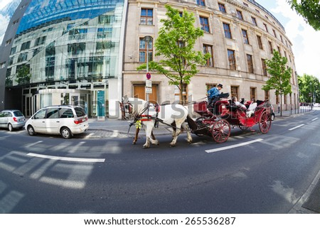 Berlin, Germany, May 12 2013: Tourists on a carriage ride near Reichstag
