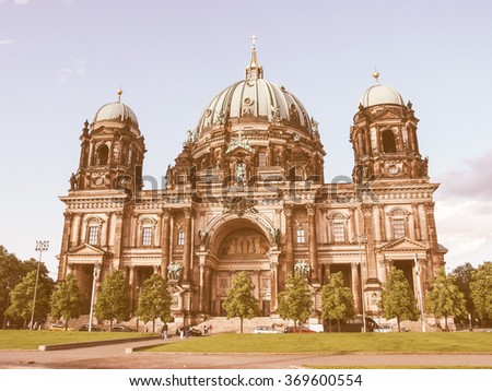 BERLIN, GERMANY - MAY 11, 2014: Tourists visiting the Berliner Dom cathedral church in Berlin Germany vintage