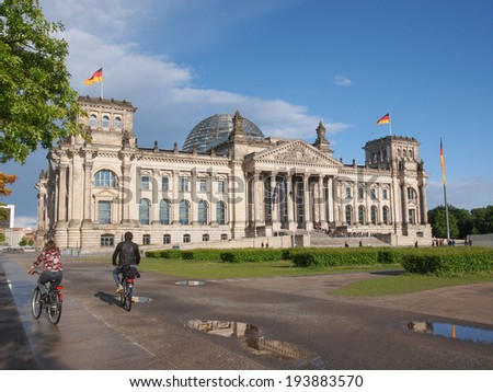 BERLIN, GERMANY - MAY 11, 2014: Tourists visiting the Reichstag (German Parliament) in Tiergarten Park