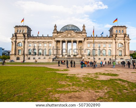 BERLIN, GERMANY - MAY 11, 2014: Tourists visiting the Reichstag (German Parliament) in Tiergarten Park (HDR)