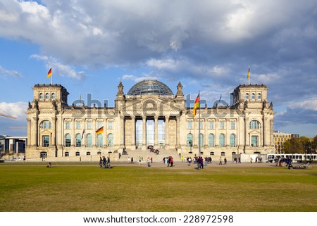 BERLIN, GERMANY - MAY 23, 2012: Tourists walk along Reichstag area in Berlin, Germany. More than 25 million people visit the city every year.