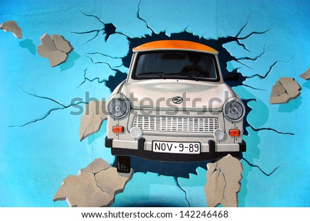 BERLIN GERMANY MAY 22: Trabant by Birgit Kinder on the Berlin Wall on may 22 2010 in Berlin Germany. East Side Gallery - the largest outdoor art gallery in the world. - stock photo