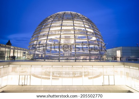 BERLIN, GERMANY - NOV 3: People visit the Reichstag dome at the German parliament on November 3 2013 in Berlin, Germany. Over 20 million people visit the city every year.