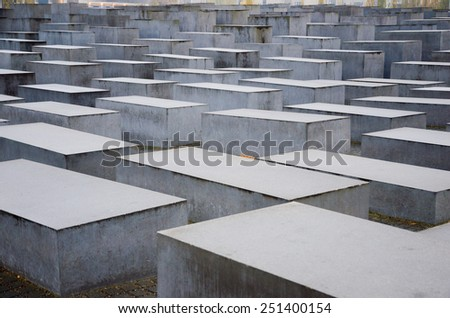 BERLIN, GERMANY - NOV 12, 2014: The Holocaust monument in Berlin, Germany. It consist of 2711 concrete blocks whit different highs and parallel alignment. - stock photo