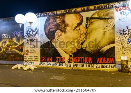 BERLIN, GERMANY - NOVEMBER 9, 2014 illuminated balloon along the former the German Berlin Wall, Detail the wall on the 25th anniversary Party of the Berlin Wall at the East Side Gallery