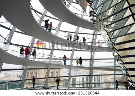 BERLIN, GERMANY - NOVEMBER 15, 2014: People visiting Reichstag dome in Berlin, Germany. The Reichstag dome is a glass dome constructed on top of the rebuilt Reichstag building  - stock photo