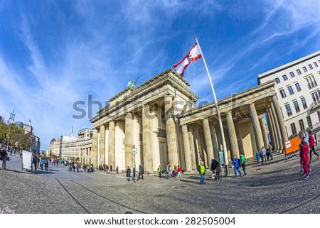 BERLIN, GERMANY - OCT 27, 2014: people visit Brandenburg Gate in Berlin, Germany. Berlin. Brandenburg Gate is a popular tourist attraction in Berlin. - stock photo