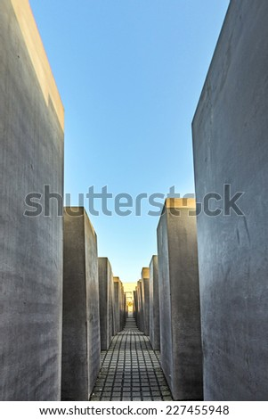 BERLIN, GERMANY - OCT 29, 2014: The Holocaust monument in Berlin, Germany. It consist of 2711 concrete blocks with different highs and parallel alignment. - stock photo