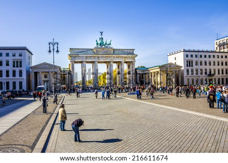 BERLIN, GERMANY - OCTOBER 19, 2012: berlins most famous landmark and national icon, situated in the middle of Berlin. It was erected in the late 18th century by the Prussian King Friedrich Wilhelm II. - stock photo