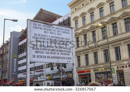 Berlin, Germany - October 26, 2013: Checkpoint Charlie streetview - it was the most famous crossing point between East and West Germany during the cold war.