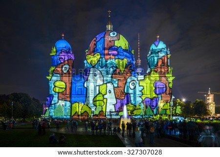 BERLIN, GERMANY - OCTOBER 9: colorful illumination of Berlin Cathedral (Berliner Dom) and TV Tower (Fernsehturm) during FESTIVAL OF LIGHTS 2015 in Berlin Mitte, Germany, Europe oct 9 2015 - stock photo