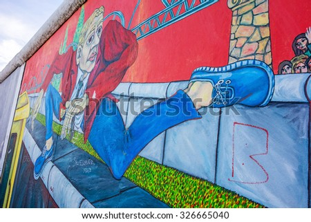 Berlin, Germany - October 26, 2013: East Side Gallery - an international memorial for freedom. Former Berlin Wall - a barrier within Germany, dividing the country. - stock photo
