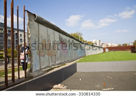 BERLIN, GERMANY, OCTOBER 03:2014 Memorial park Berlin wall is memorial built on the place of berlin wall which nowadays shows remnants of it, photos of victims killed during espace and memorials.