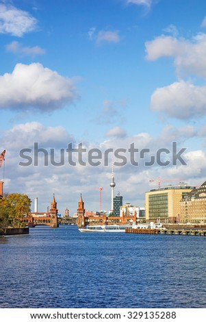 Berlin, Germany - October 29, 2013: Skyline of Berlin with view of the TV Tower at Alexanderplatz square and Bridge Oberbaumbruecke